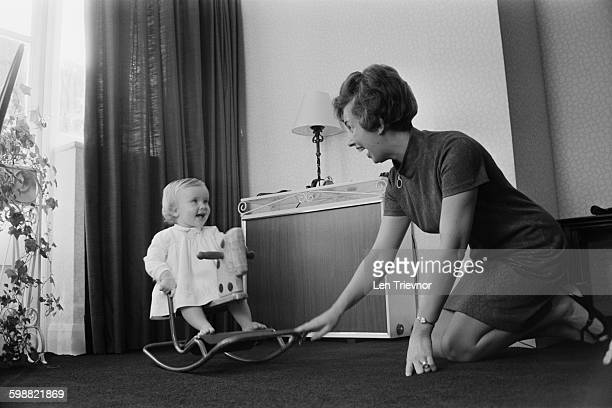 Mrs Derek Butler with her daughter Louise beside the radiator in their home UK 23rd October 1967 Image taken for a supplement on central heating in...