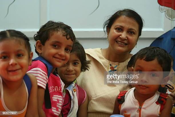 Mrs Devi Singh Roy Principal Shishu vihar with school children