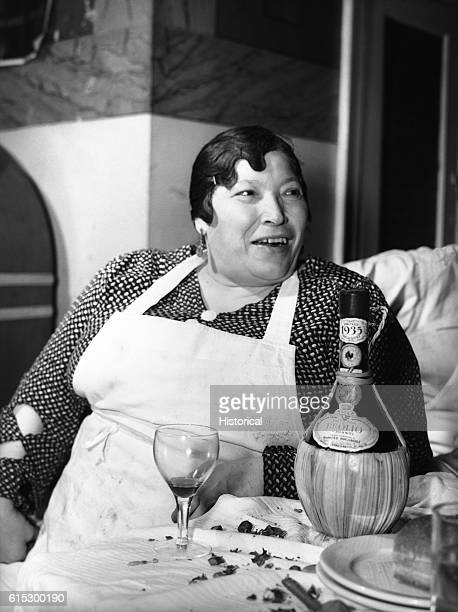 Mrs Di Costanzo towards the end of the family's annual New Year's eve feast The family owned a restaurant on Mulberry Street New York New York...