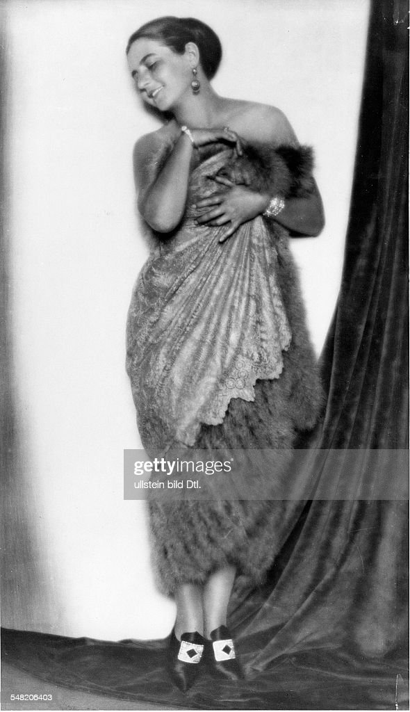 Mrs. Diamant wearing a lace evening gown with feathers. Picture by ...