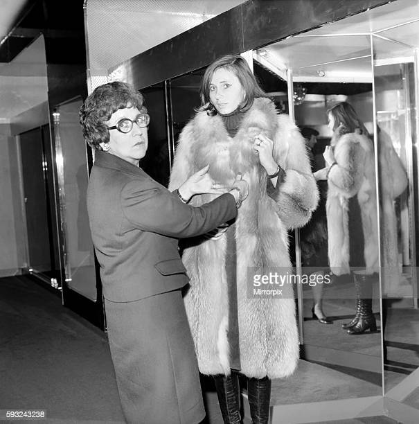 Mrs Diana Leonard of West London trying on a £575 red fox fur coat She did not buy it but was prepared to spend the money and would have done so had...