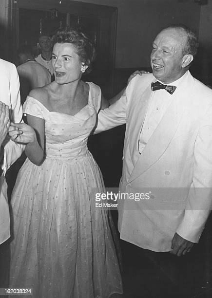 Mrs. Donald Robertson and J. Ramsay Harris pause to chat with friends during the recent Central City Opera ball. An elaborate Silver Heels ball is...