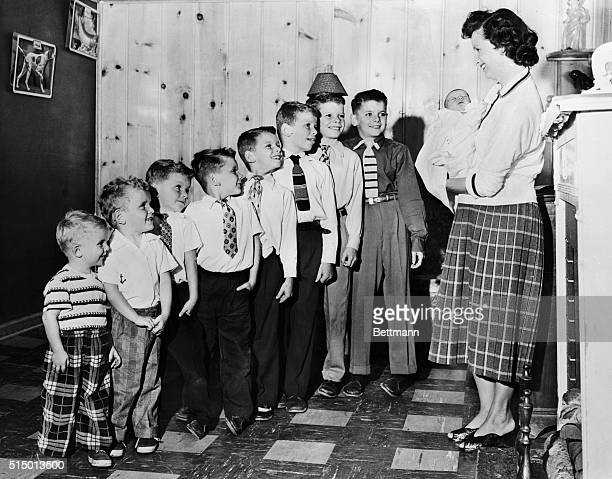 Mrs Dorothy Langohr introduces her newest son three day old Douglas to his brothers all eight of them in their Detroit home The lineup Dean 11 Donald...