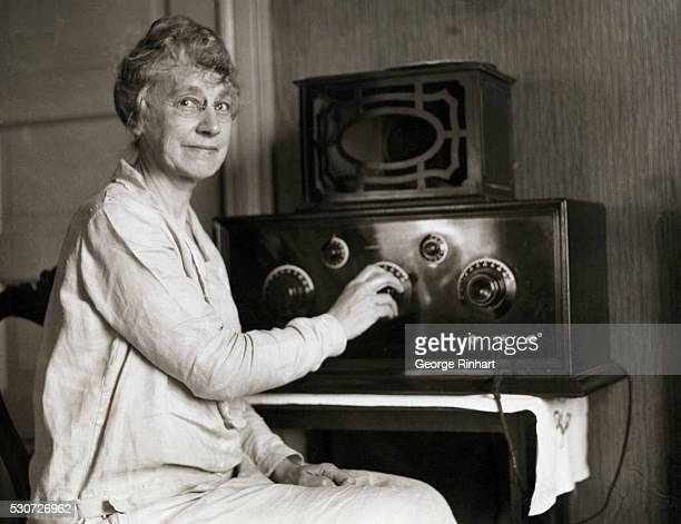 Mrs Earhart mother of Amelia Earhart in Medford Mass waits for news of her daughter's transAtlantic flight With her radio she keeps in touch with the...