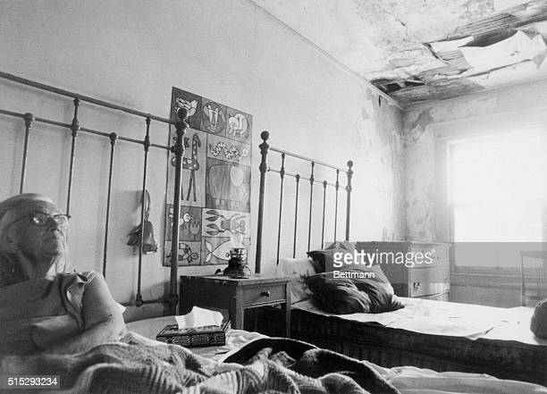 Mrs Edith Beale lies in bed near crumbling ceiling in room of run down 28 room mansion here Papers protect her bed