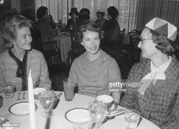 Mrs Edrena Phipps Ambler left exchanges party talk with Mrs George Wilcox center and Mrs William Gerber at Denver Country Club luncheon and fashion...