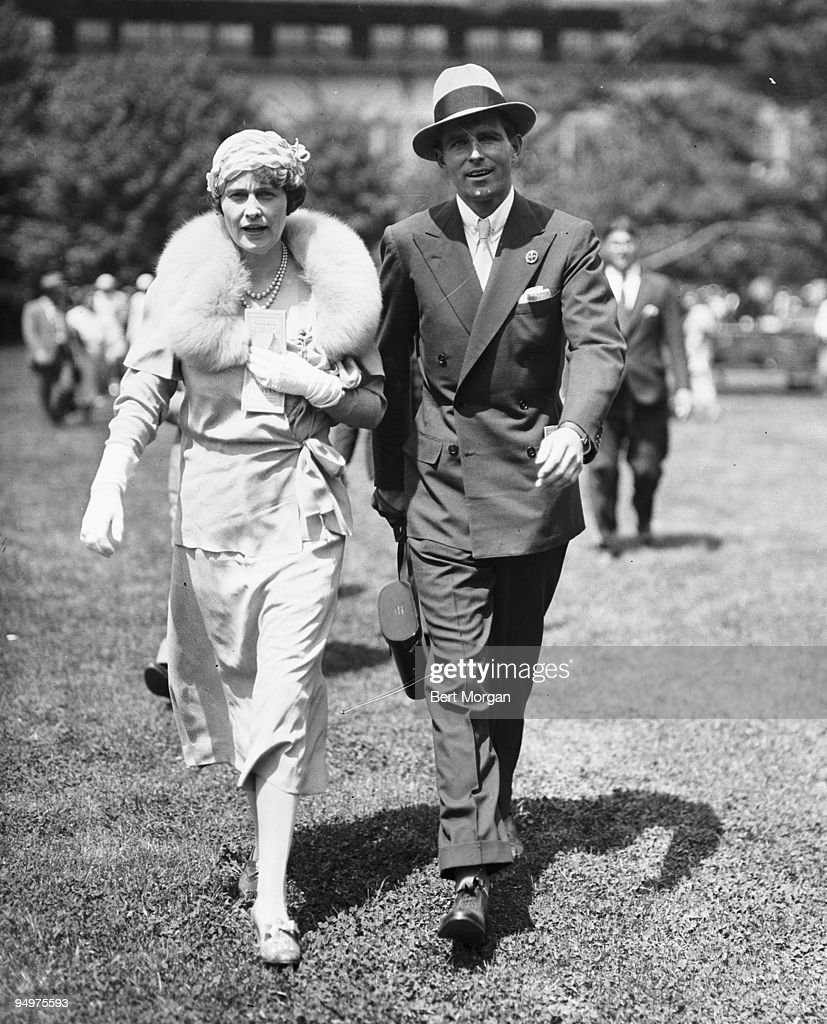 """Mrs Edward F Hutton (General Foods heiress Marjorie Merriweather Post) and her son-in-law Thomas Wells """"Tim"""" Durant walk together at Belmont Park race track, NY, May 29, 1933 : News Photo"""