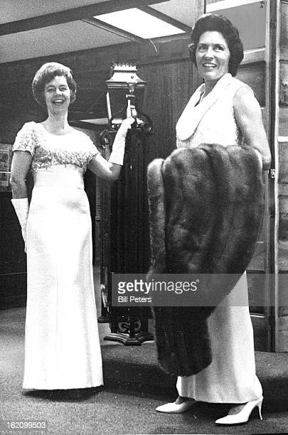 SHOW Mrs Edward Phillips left and Mrs Edwin Van Cise model gowns from GanoDowns to be shown Oct 27 at Swedish Medical Center Auxiliary fashion show...