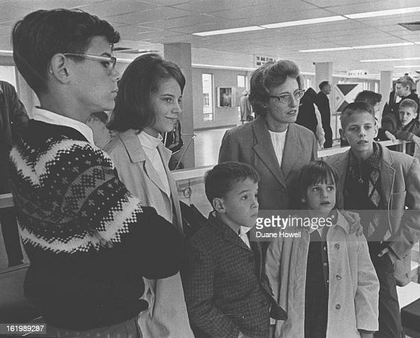 Mrs Edythe Knue And Five Children Arrive From Lahore Pakistan Children are from left Joseph 13 Nancy 14 Gregory 8 Mary and James 11 The JE Knue...