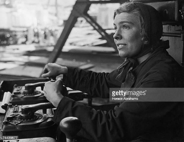 Mrs Eileen Reay drives a crane in a British shipyard during World War II 1942