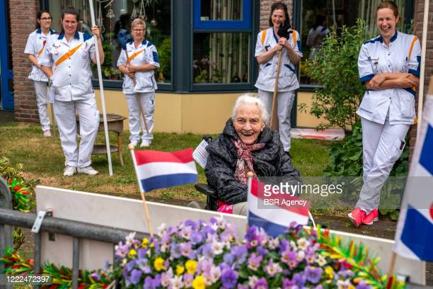 Mrs Eke Jouwsma Galema is seen celebrating her 100th birthday amid the coronavirus outbreak on May 2, 2020 in Sint Nicolaasga, Netherlands. Because...