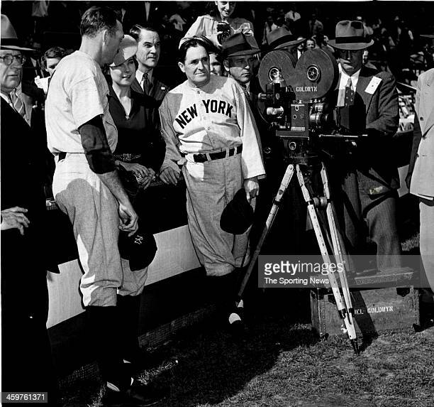 Mrs Eleanor Gehrig Christy Walsh and Joe McCathy look on as media takes photos of Lou Gehrig prior to Lou's last game at Ebbet's Field April 30 1939...