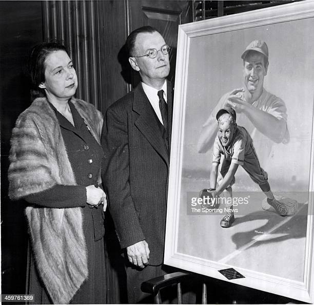 Mrs Eleanor Gehrig widow former New York Yankees player Lou Gehrig stands next to Laurence G Payson secretary and treasurer of the Board of Governors...