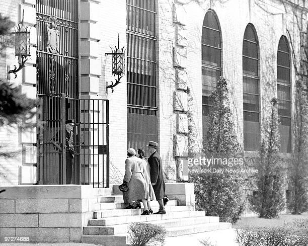 Mrs Ethel Rosenberg convicted spy sentenced to death mounts steps to Sing Sing Prison administration building between Deputy Marshals Sarah Goldstein...
