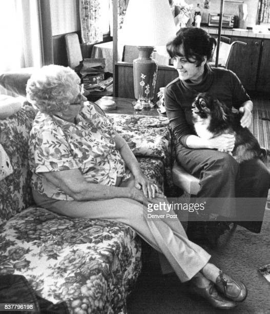 Mrs Eva Crosse 80 yrs Old Yvonne Kent 45 yrs Old Mrs Crosse pet dog take a rest after doing a litttle moving in Credit Denver Post