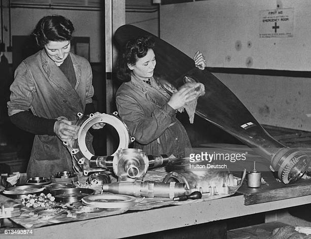 Mrs F Hills and Miss March repair shop workers polish propeller component parts 1942