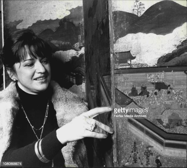 Mrs Fiorella de BoosSmith of Vaucluse as she inspects the screenPictures of an Oriental art exhibition in the David Jones art Gallery which is in...