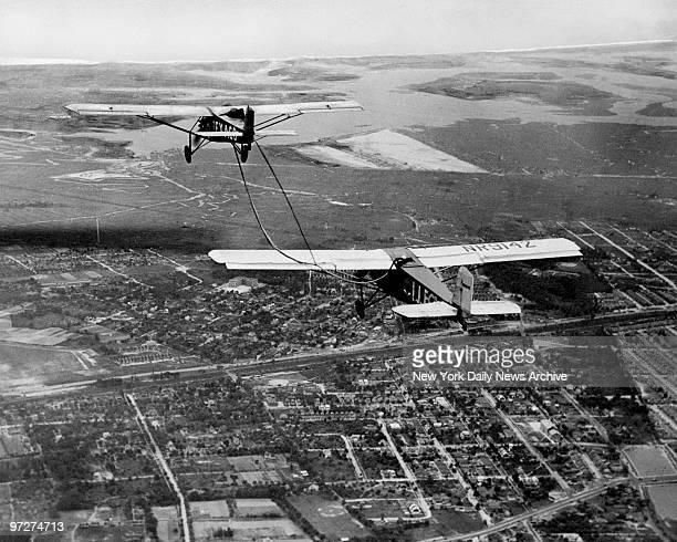 Mrs Frances Marsalis refueling endurance plane as Mrs Louise Thaden pilots plane