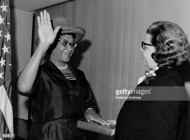 Mrs Frankie Muse Freeman is sworn in as the first woman member of the new US Commission on Civil Rights on October 6 1964 in Washington