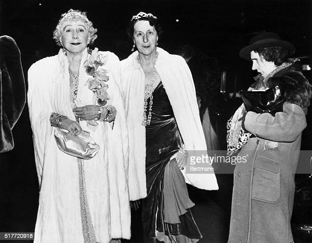 Mrs. George Washington Kavenaugh and Lady Decies, decked out for the opera, enter the Metropolitan Opera House smilingly unaware of the drunken woman...