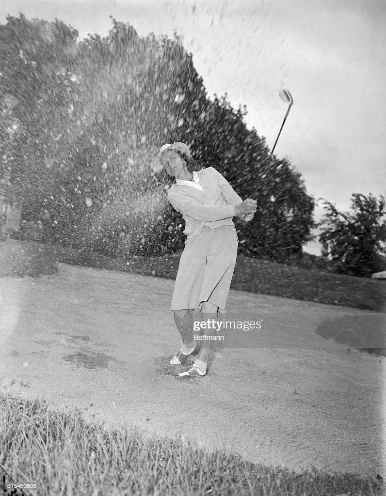 Babe Didrikson Spraying Sand with Golf Swing : News Photo