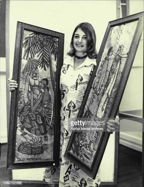Mrs Glynis Szafranies from Penrith who is helping to organize the exhibition is seen her cataloging two Bartik paintingsAs part of the August Noon...