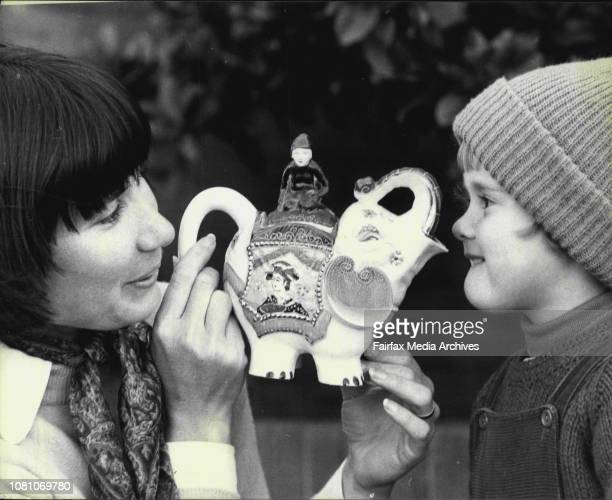 Mrs Greta Archbold of Roseville and daughter Victoria admire a 19th century Victorian eccentric elephant teapot one of a collection of 200 teapots...