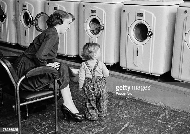 Mrs Grundy and her son, Douglas at a launderette near their home in Surbiton, Surrey, April 1957.
