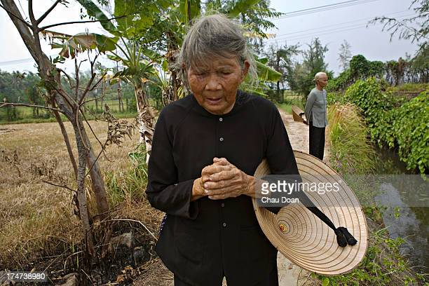 Mrs Ha Thi Quy a survivor of the My Lai massacre visits the Thuan Yen ditch where she nearly died Her mother a daughter and a son were killed in the...