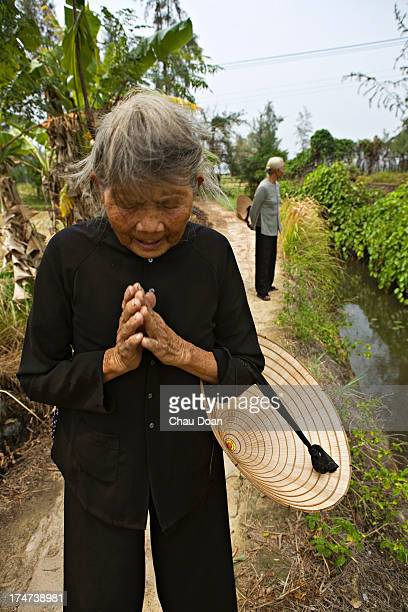 Mrs Ha Thi Quy a survivor of the My Lai massacre, visits the Thuan Yen ditch where she nearly died. Her mother, a daughter and a son were killed in...
