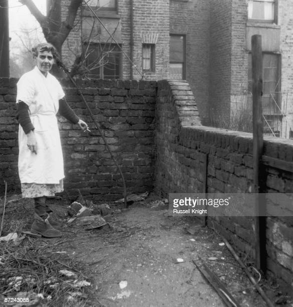 Mrs Hart the neighbour of serial killer John Reginald Christie points to the spot in the garden of 10 Rillington Place London where two of his...