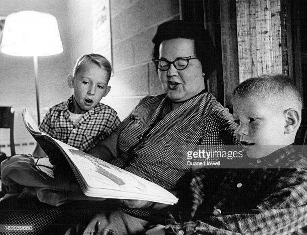 SEP 29 1965 OCT 6 1965 Mrs Helen Meanor a cottage parent reads to two of the younger boys They are Almer Flint and Richard Patterson 7 There are four...