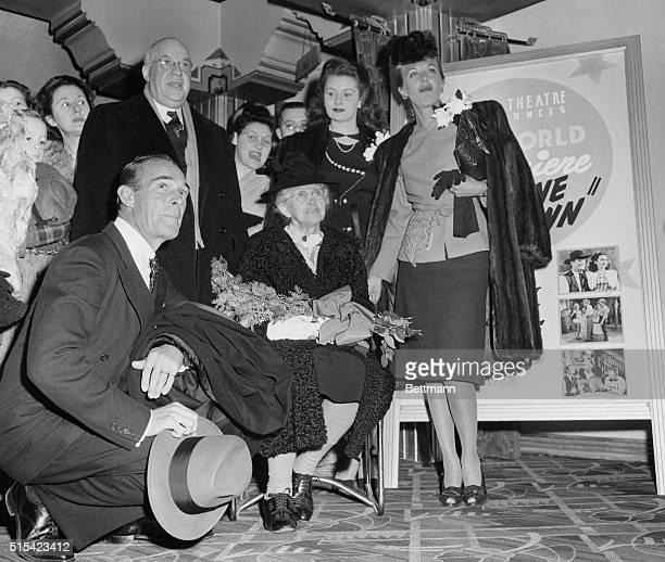 Mrs Ida Eisenhower honored guest at World Premier of Abilene Town is surrounded by its stars Randolph Scott Rhonda Fleming and Ann Dvorak in Lobby of...