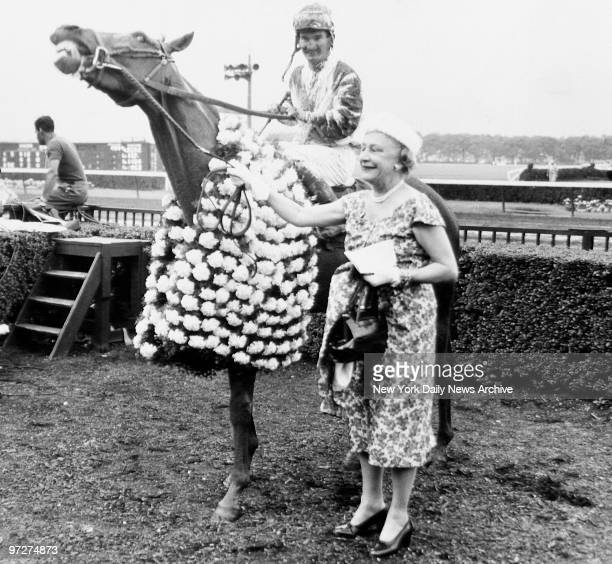 Mrs Isobel Dodge Sloan with her horse Sword Dancer and jockey Willie Shoemaker after he rode to victory in the Belmont Stakes