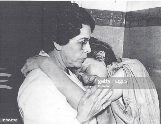 Mrs Isobel Dyer wife of Albert Dyer declared guilty today of the attack murders of three Inglewood children sobs on the shoulder of matron Vada...