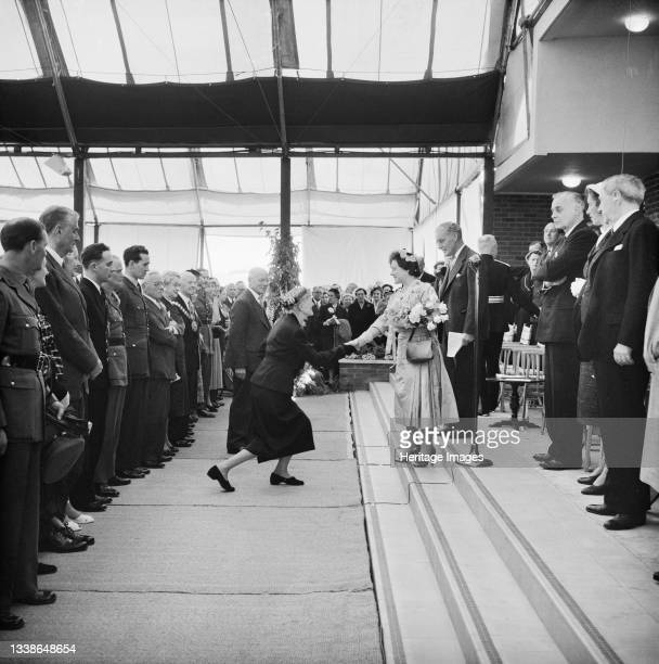 Mrs J. W. Laing being presented to Her Majesty Queen Elizabeth, the Queen Mother, at the ceremonial opening of Coryton Oil Refinery. Coryton Oil...