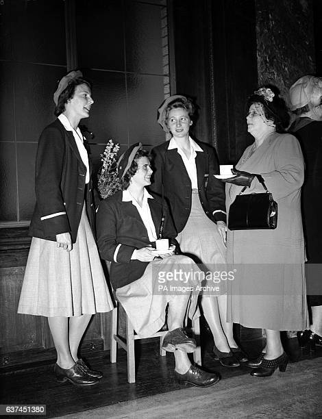 Mrs JA Beasley the Australian High Commissioner's wife talks to Australian athletes Judy Canty June Mason and Shirley Strickland