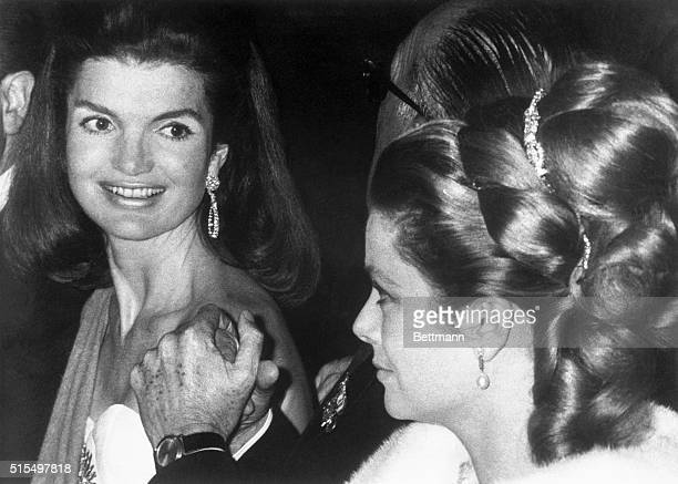 """Mrs. Jacqueline Kennedy and American-born Princess Grace of Monaco """"steal the show"""" as they attend Spain's gala debutante ball at the Palace De..."""