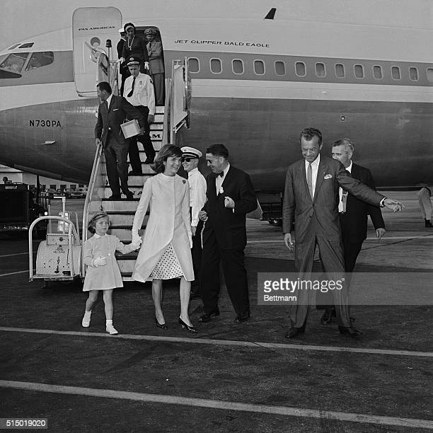 Mrs Jacqueline Kennedy and daughter Caroline arrive here at Idlewild Airport in New York after their gala three week vacation in Ravello Italy The...
