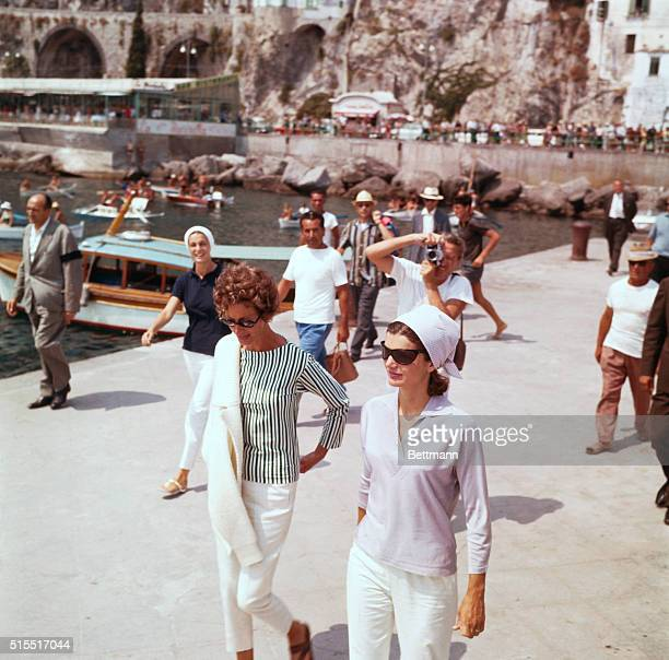 Mrs Jacqueline Kennedy and Mrs Agnelli on a pier in Amalfi before embarking on the yacht Agneta