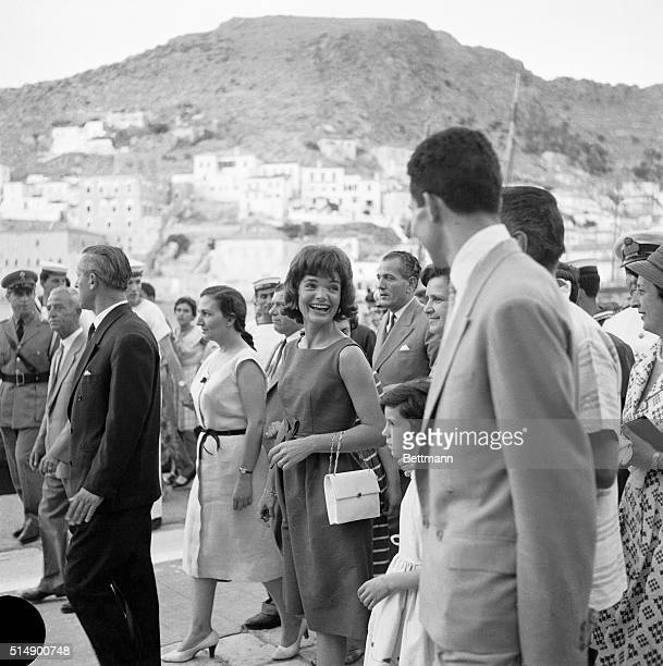 Mrs Jacqueline Kennedy appears to be enjoying her vacation in these islands as she smiles at a wellwisher here June 9th While in Greece Mrs Kennedy...