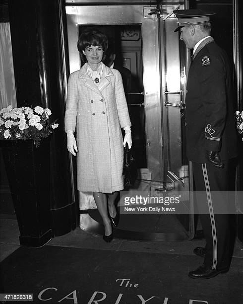 Mrs Jacqueline Kennedy cuts a bright figure as she leaves Carlyle Hotel to do some Christmas shopping The First Lady said she was going to buy a gift...
