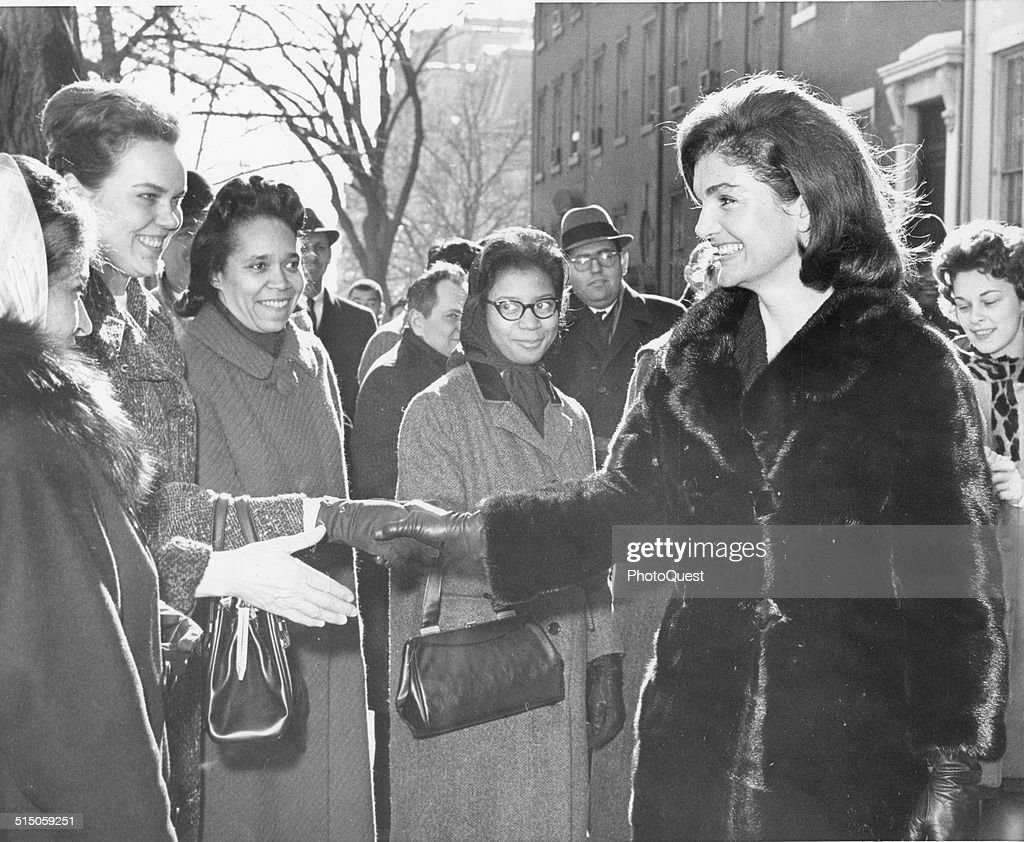 Mrs Jacqueline Kennedy greets well-wishers near the White House after she had visited the offices near there where volunteers have been handling the flood of mail received following the assassination of her husband, Washington DC, January 10, 1964. Mrs Kennedy visited the offices to thank the volunteers for their help.