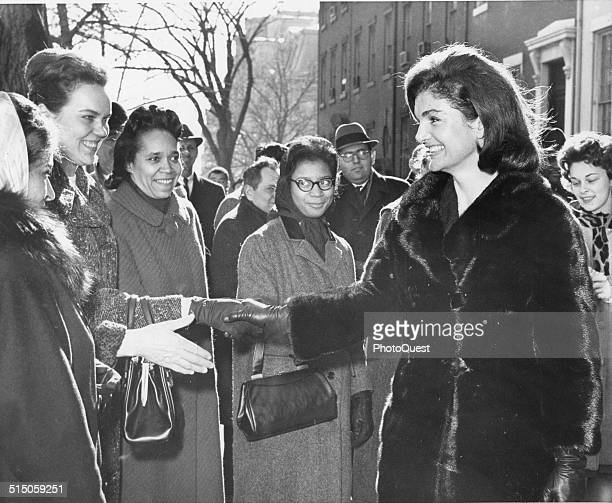 Mrs Jacqueline Kennedy greets wellwishers near the White House after she had visited the offices near there where volunteers have been handling the...