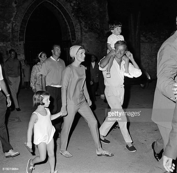 Mrs Jacqueline Kennedy holds the hand of her daughter Caroline while Gilbert Graziana a friend carries her nephew Anthony Radziwill and her sister...
