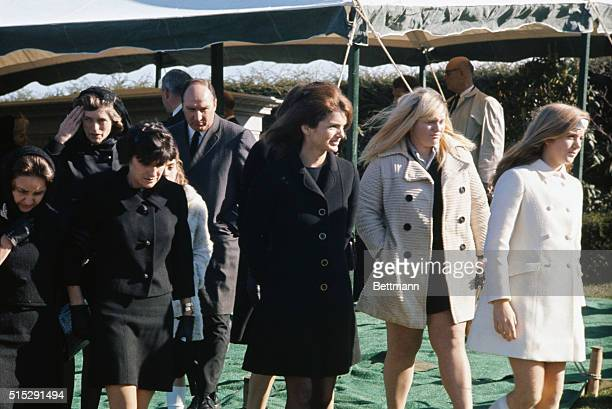 Mrs Jacqueline Kennedy Onassis leaves Holyhood Cemetery after funeral services for her late former fatherinlaw Joseph P Kennedy Her daughter Caroline...