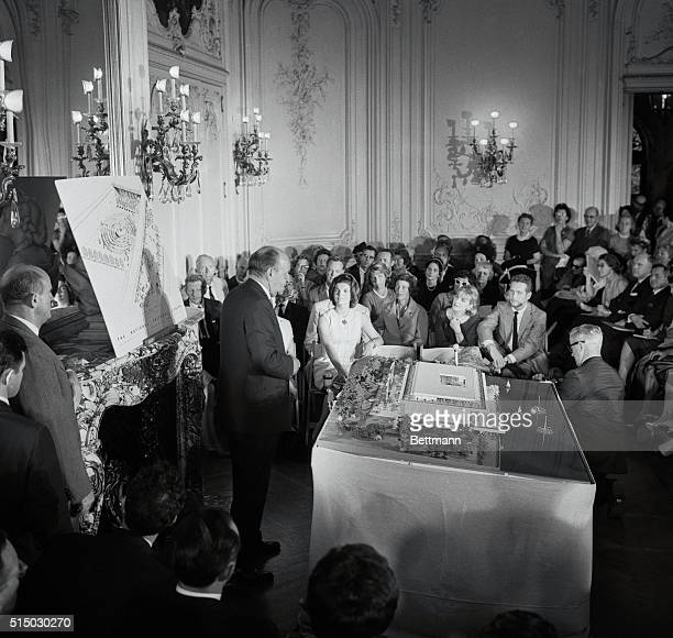 Mrs Jacqueline Kennedy sits with her mother Mrs Auchincloss and architects Edward Durrell Stone during ceremonies where model of proposed National...