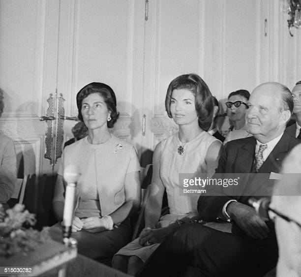 Mrs Jacqueline Kennedy sits with her mother Mrs Auchincloss and architects Edward Durrell Stone during ceremonies where a model of the proposed...