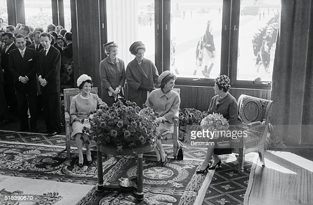 Mrs Jacqueline Kennedy talks to Madame De Gaulle after her arrival here with President Kennedy May 31st Others in the party are Mrs Joseph P Kennedy...