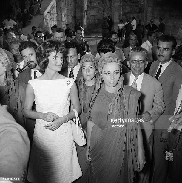Mrs Jacqueline Kennedy walks with Greek costumed players on a tour of the ancient amphitheater here June 8th Mrs Kennedy arrived on the 'North Wind'...